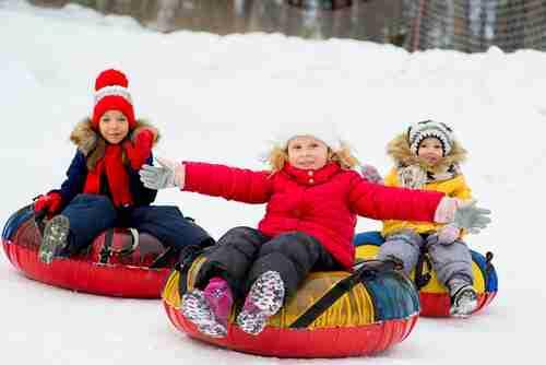 kids on snow tubes