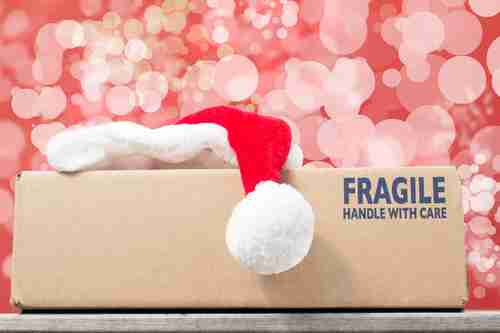 santa hat on fragile box
