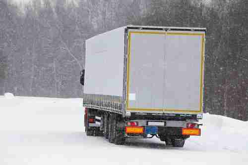 moving truck in snow